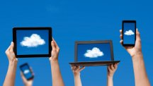 Laptops and tablet with clouds on the screen