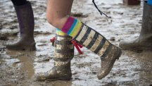 Festival-goer in wellies