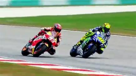 Screengrab of Valentino Rossi and Marc Marquez racing each other.