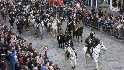 Some of the 280 horses ride up the Royal Mile during the Edinburgh Riding of the Marches, in a tradition which harks back to the Common Ridings of Scotland