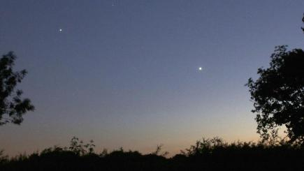 Jupiter, left, and Venus will appear to be unusually close together (Robin Scagell/Society for Popular Astronomy/PA)