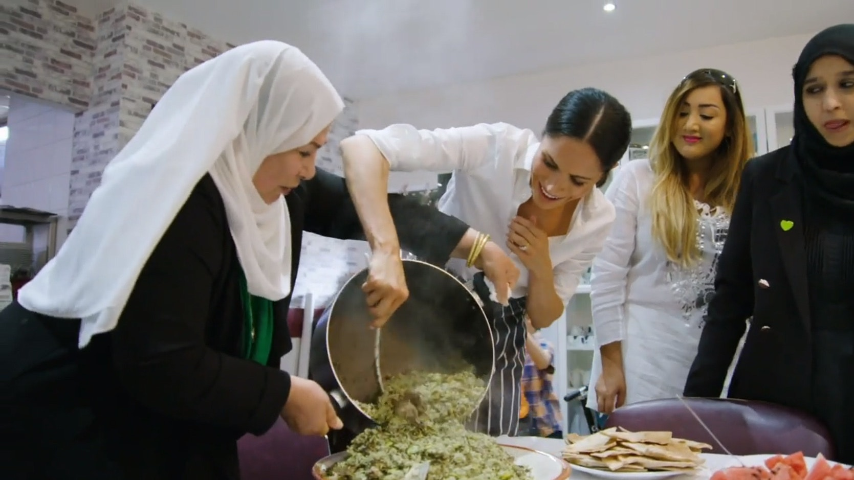 Meghan unveils Grenfell cookbook after pitching in at community kitchen