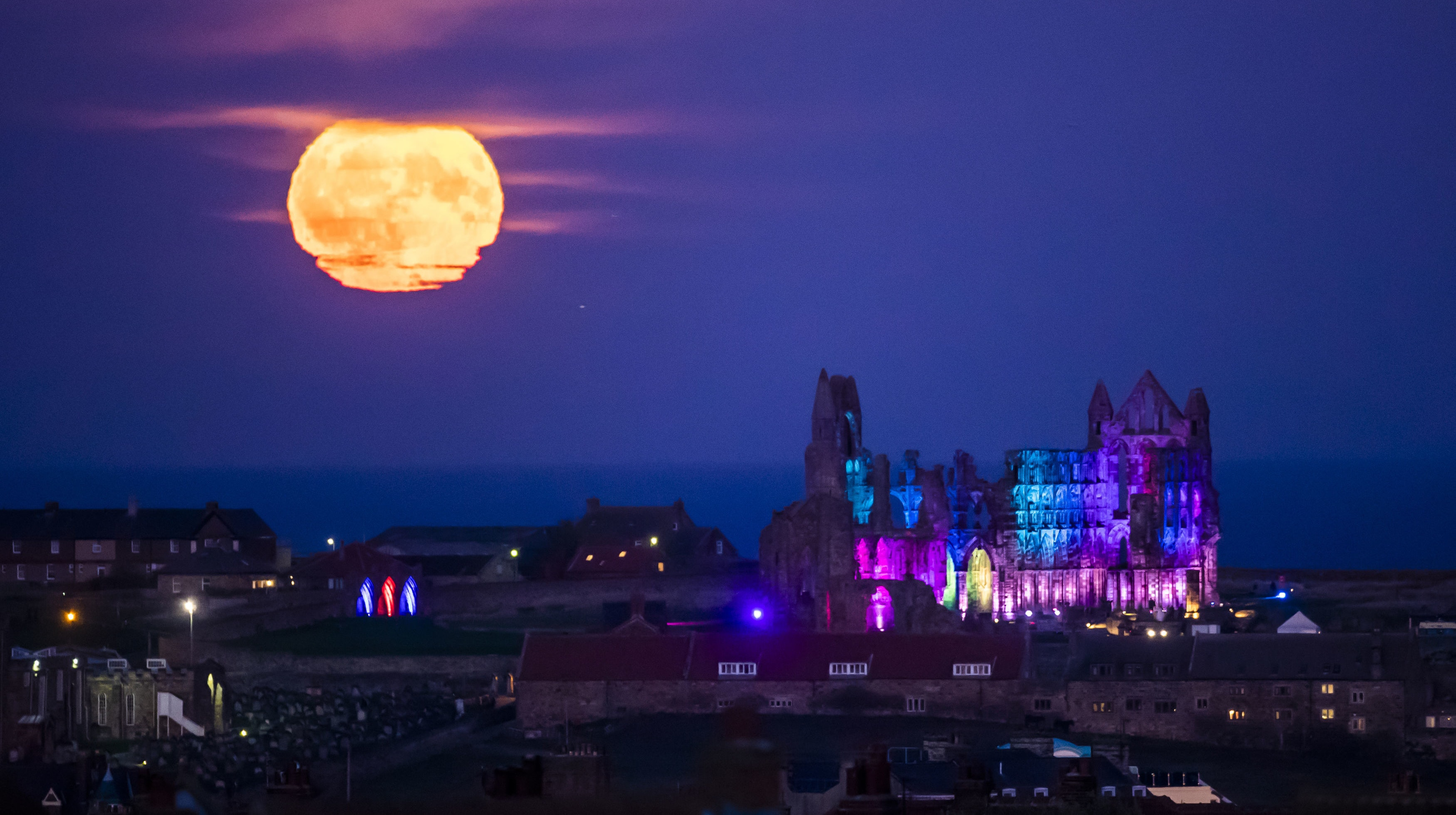 In Pictures Moon Rises As Whitby Abbey Lights Up For