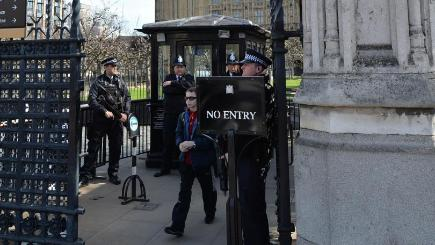 Armed police at Carriage Gates, one of the entry points to the Palace of Westminster in central London.