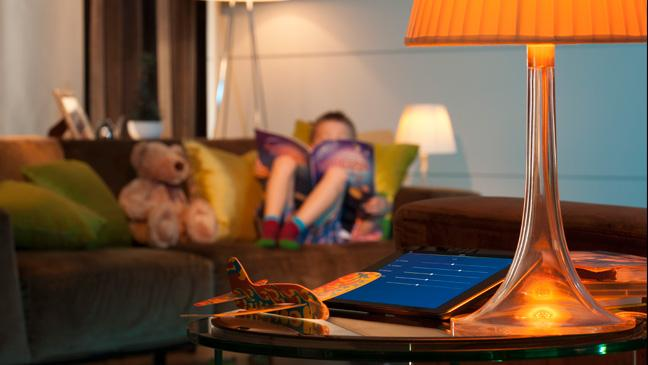 iPad in living room with child on sofa