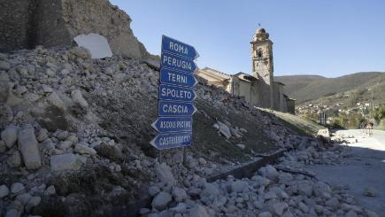The tower of a church is still standing amid rubble on a road near Norcia after the earthquake (AP)