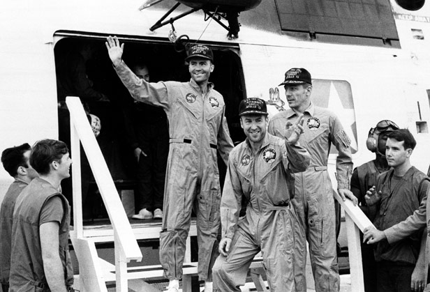 Apollo 13 crew members Fred Haise, Jim Lovell and Jack Swiggert aboard the USS Iwo Jima on their return to Earth.
