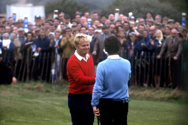 Jack Nicklaus (left) shakes hands with Tony Jacklin as their 1969 singles match ends all-square.