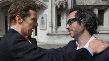 Concert pianist James Rhodes (right) hugs actor Benedict Cumberbatch as he leaves the Supreme Court in London after winning the right to publish an autobiographical book giving detail of sexual abuse he suffered as a child. (PA)