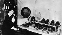 Jane Cain, the first voice of the speaking clock in 1936, sitting at the speaking clock equipment.