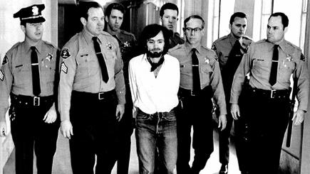 Charles Manson being led away after being convicted of murder