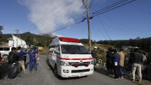 An ambulance carries casualties away from Mount Ontake. (AP)