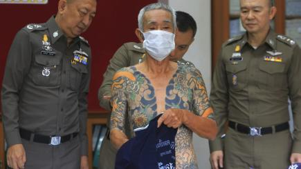 Tattoos lead Thai police to fugitive Japanese gang member