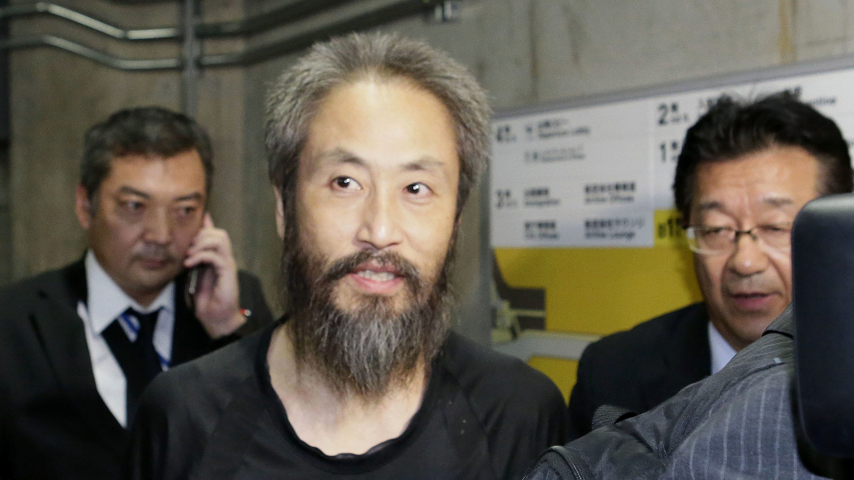 Japanese journalist freed from Syria happy to be home after 'hell'