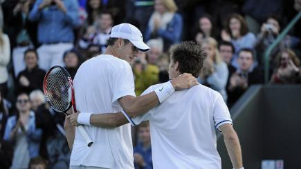 John Isner and Nicolas Mahut at the end of their mammoth tennis match.