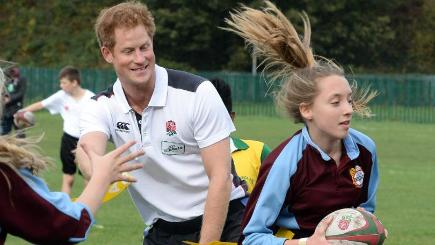 Prince Harry, patron of England Rugby's All Schools Programme, joins a game at Eccles Rugby Club, but experts say not enough is being done to protect youngsters from injury
