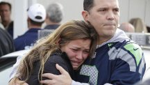 Families wait at a church as the school shooting horror unfolds (AP)