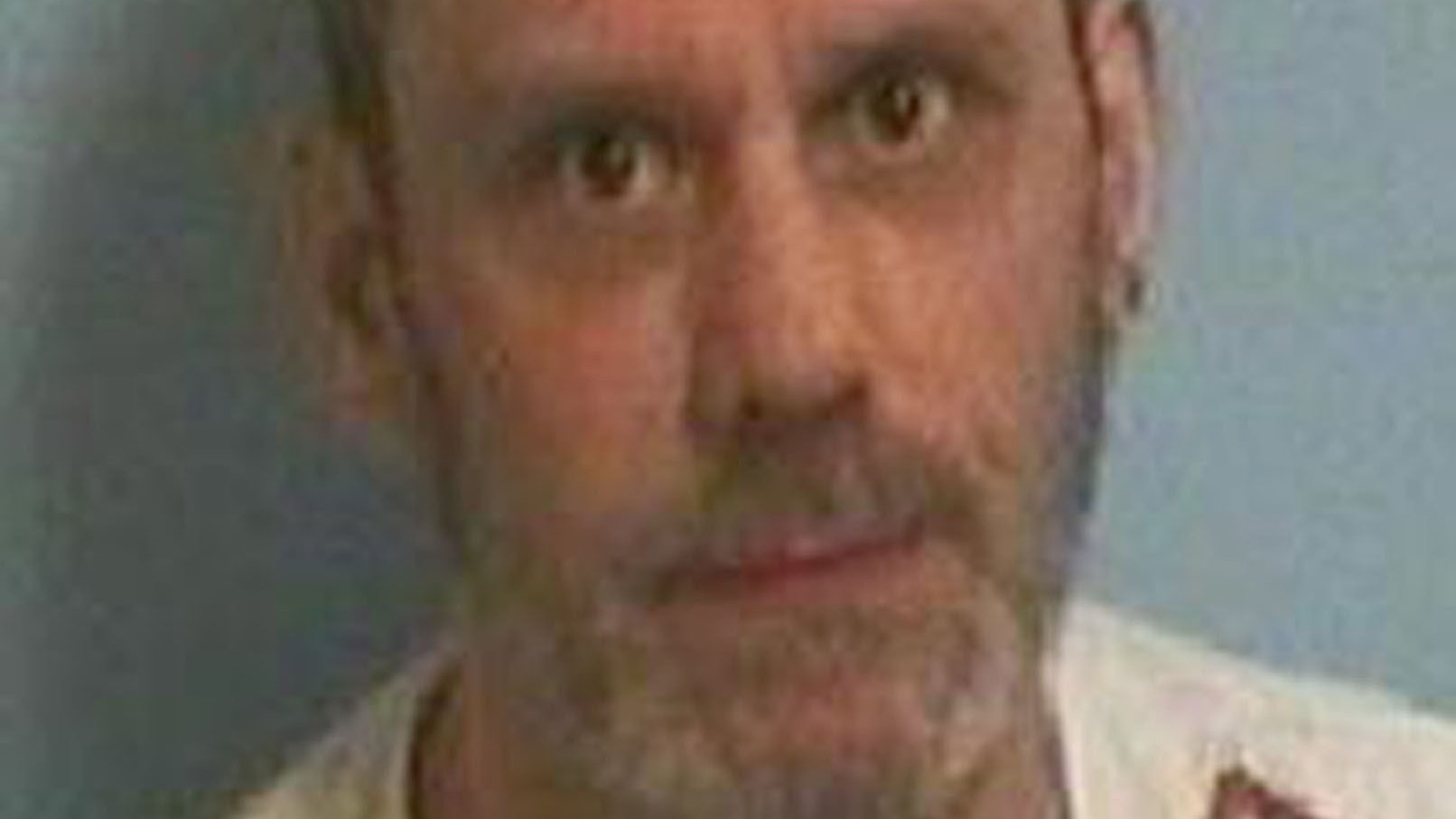 Convicted London killer is on the run after being released from prison