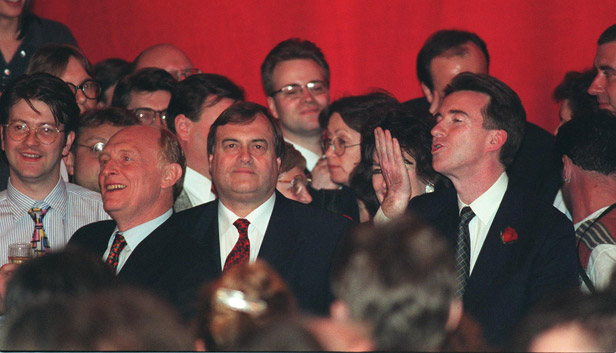 Neil Kinnock, John Prescott and Peter Mandelson celebrate Labour's landslide win at London's Festival Hall.