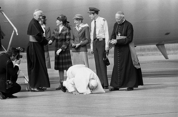 The Pope kisses Welsh soil on his visit to the UK in 1982.