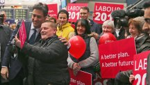 Labour Party Leader Ed Miliband poses for a selfie with supporters