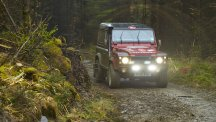 A Land Rover Defender tackling tough terrain in South Wales.