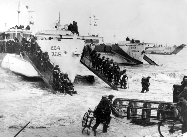 Troops coming ashore from a landing craft for the D-day landings at Normandy.