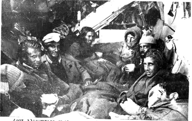 Eight of the survivors spend their last night on the crashed plane; mountain rescue workers had brought them food and drink.