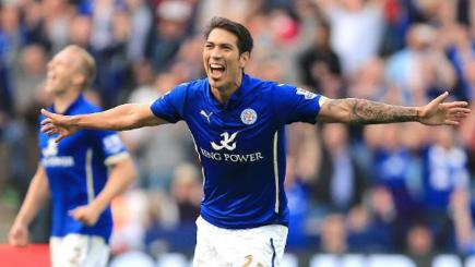 Leicester striker Leonardo Ulloa celebrates one of his two goals against Manchester United today.
