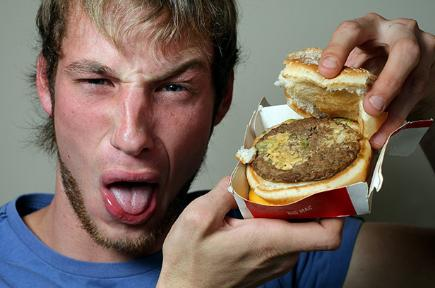 Leigh Savage with the Big Mac hamburger he bought from a McDonald's store in Frankston, Victoria, which he claimed contained 30 to 40 live maggots.