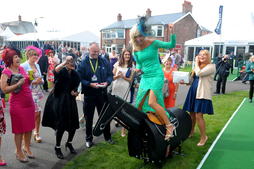 Let's hope green is her lucky colour for this have a go jockey.