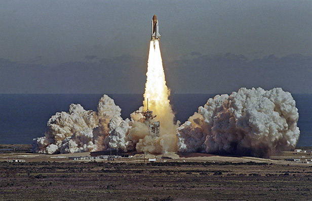 The Space Shuttle Challenger lifts off on its ill-fated final journey
