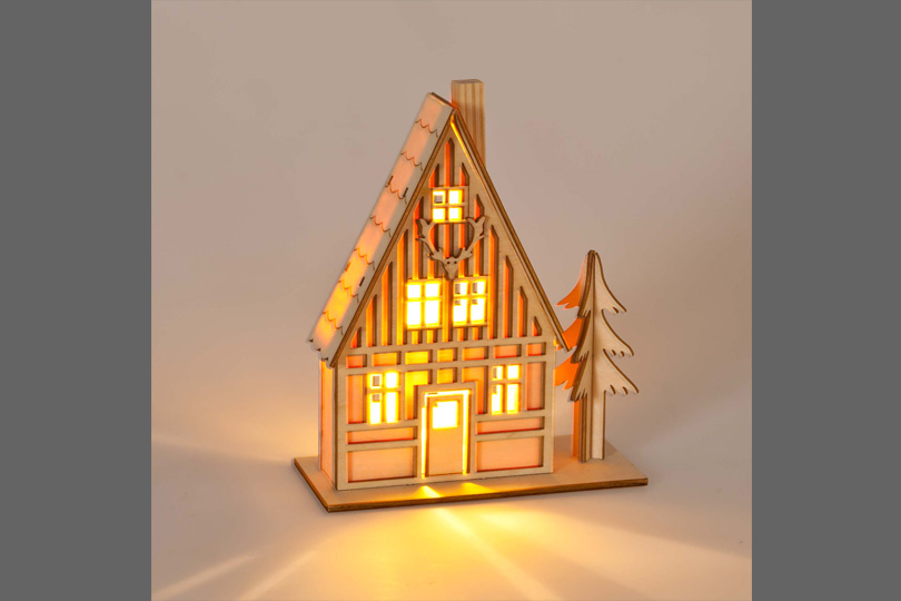 Light-up house Christmas decoration, £9.99. Available from Zara Home.