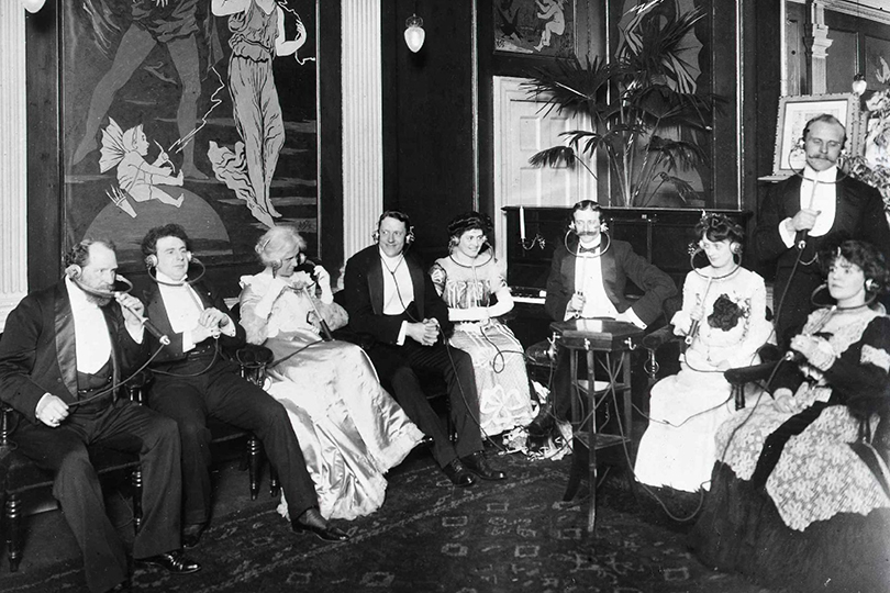 Listening remotely to a play at a London theatre live by Electrophone. 1908.