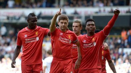 Liverpool players celebrate Steven Gerrard's penalty in their 3-0 win at Spurs.