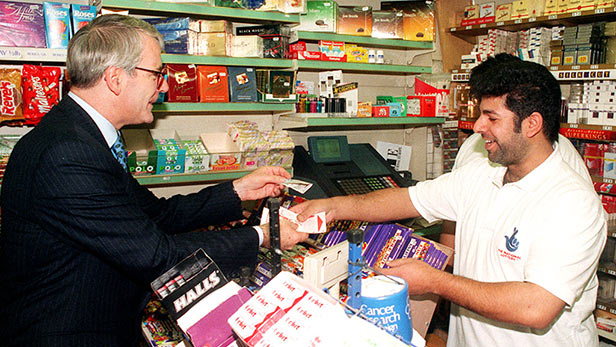 Prime Minister John Major buys a lottery ticket