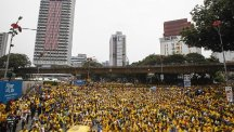 Activists from the Coalition for Clean and Fair Elections (Bersih) gather on a main road in Kuala Lumpur, Malaysia. (AP)