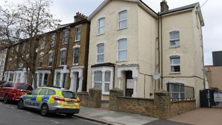 The scene in Wilberforce Road after a one-year-old boy died and a girl of the same age was left in a critical condition in a flat