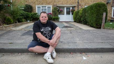 David Gordon, a taxi driver from Southend, pictured outside his house where he was fined for parking across his own driveway. Photo credit: SWNS