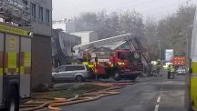 Firefighters remain at the scene of a blaze at a fireworks factory in Stafford