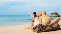 Man on beach with smartphone