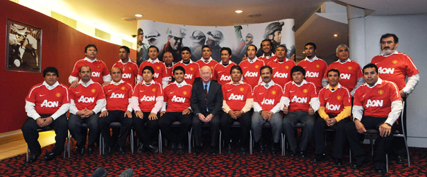 Two months after their ordeal ended, the miners were guests of Manchester United.