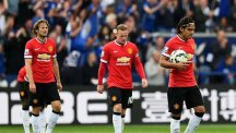 Manchester United players look dejected during their defeat by Leicester City yesterday.