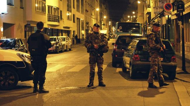 Manhunt under way as President Francois Hollande says Islamic State was behind Paris attacks