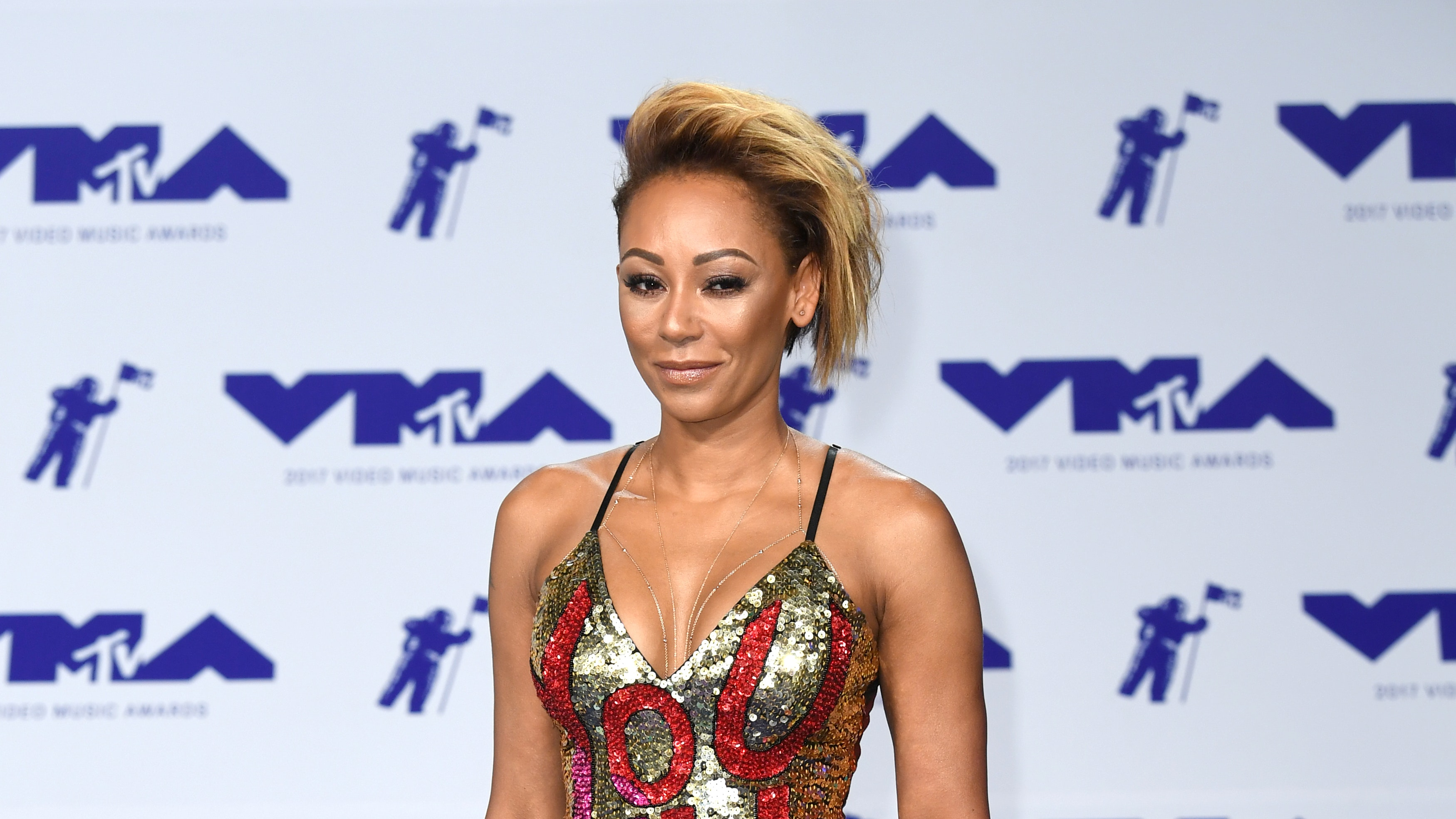 SCARY SPICE SURGERIES: Mel B admits to having 'nips and tucks'