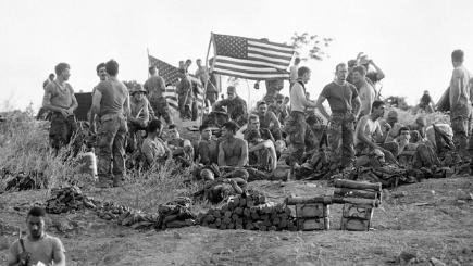 Members of the 82nd Airborne relax on a hill near Point Salines Airport in Grenada.