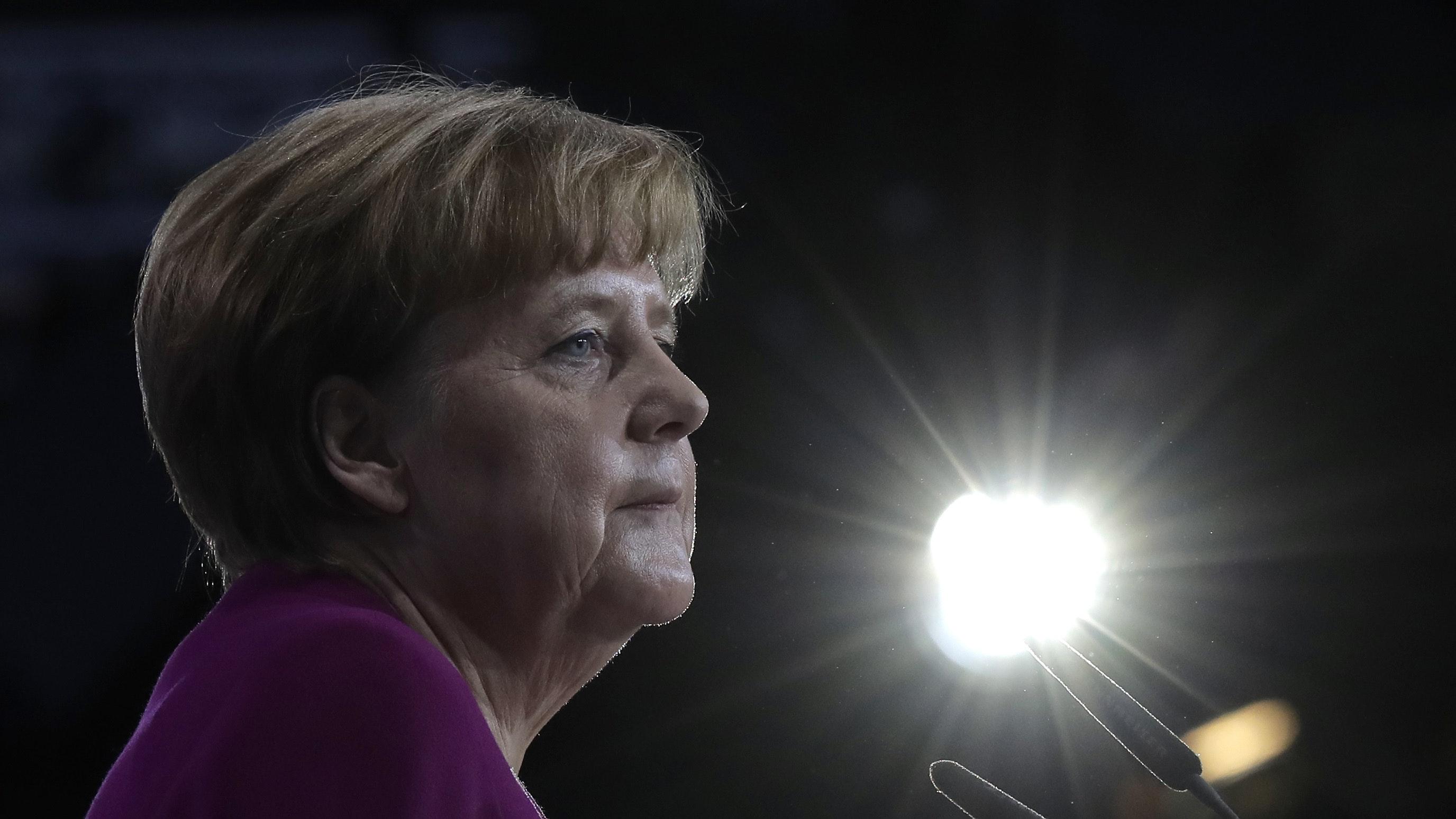 Merkel vows party renewal in bid to quell rebellion