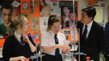 Labour leader Ed Miliband visits Hazelwood Integrated College in North Belfast, where he met pupils and watched science experiments (PA)