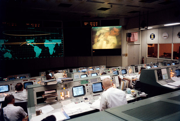 The Mission Operations Control Room in Houston's Mission Control coordinates the rescue of Apollo 13, with astronaut Fred Haise pictured on the big screen. Photo credit: Nasa