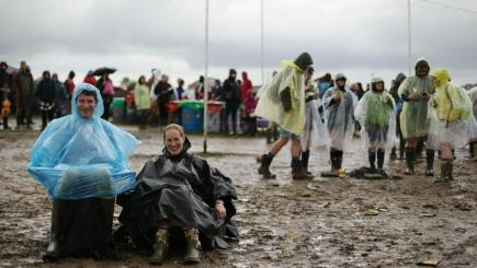 Revellers brave the elements at the Glastonbury Festival